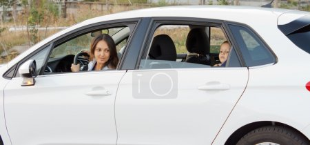 Mother and her small son waiting in a car