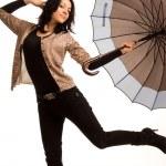 Постер, плакат: Playful woman posing with an umbrella