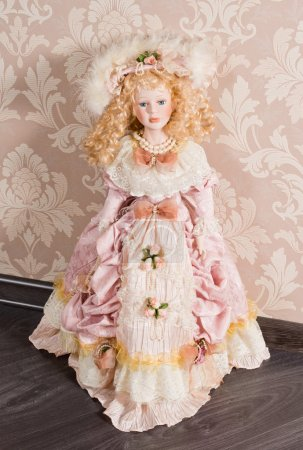 Antique doll in beautiful clothes