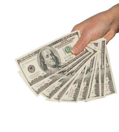 Man holding a fistful of 100 dollar bills