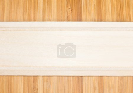 Photo for Natural light wood banner formed from the partial view of a wooden kitchen utensil place horizantally over darker wood with a definite woodgrain pattern - Royalty Free Image