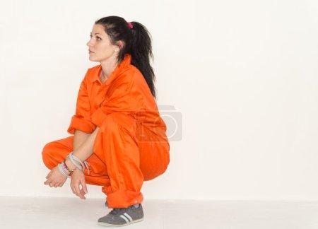 Woman in bright orange overalls