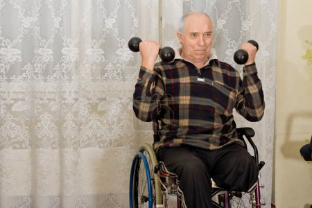Handicapped senior man working out