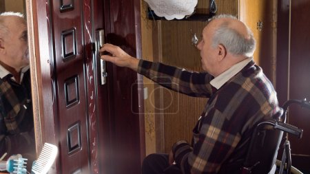 Man in a wheelchair checking his house locks
