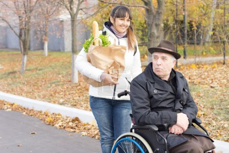 Woman helping a disabled man with shopping