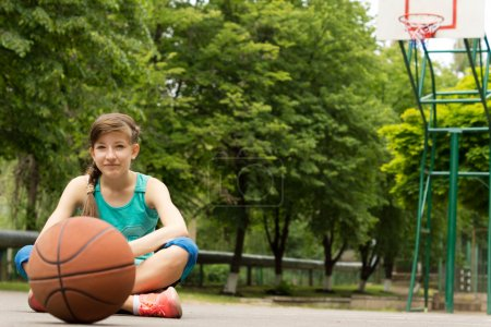 Beautiful confident young female basketball player