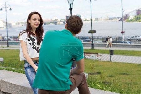 Attractive girl chatting to her boyfriend