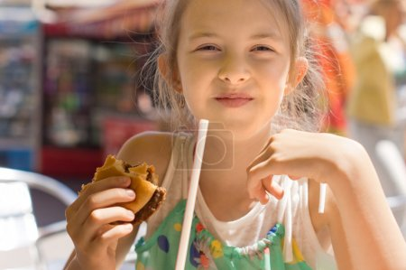 Girl having the lunch at a fast-food restaurant