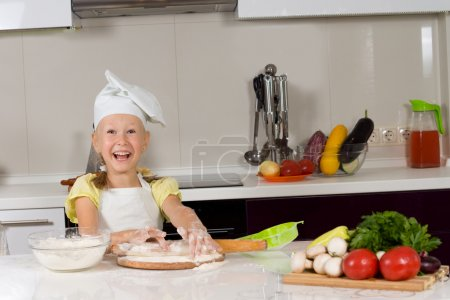 Cute young girl in the kitchen