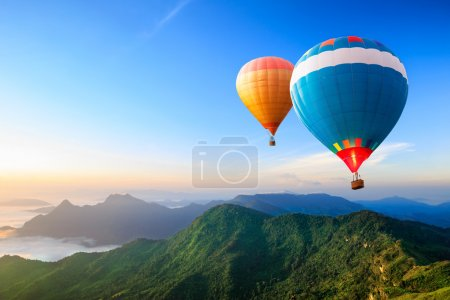 Photo for Colorful hot-air balloons flying over the mountain - Royalty Free Image
