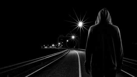 Photo for Teenager boy standing alone in the street at night, Black & White tone - Royalty Free Image
