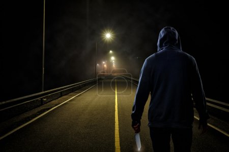 Photo for Murderer on the road in the night - Royalty Free Image