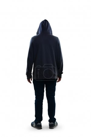 Sad teenage boy standing rear view