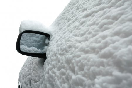 Snow covered car in winter