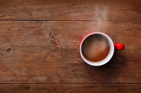 Photo for Red cup coffee on old wood background in morning time - Royalty Free Image