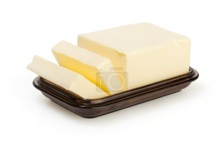 Butter on butter-dish on white background with cli...
