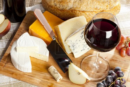Photo for Red Wine And Assorted Cheese Plate with fruit - Royalty Free Image