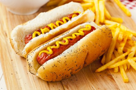 Photo for Organic All Beef Hotdog on a bun with mustard - Royalty Free Image