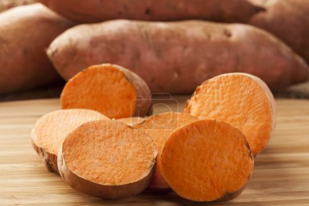 Photo for Fresh Organic Orange Sweet Potato against a background - Royalty Free Image