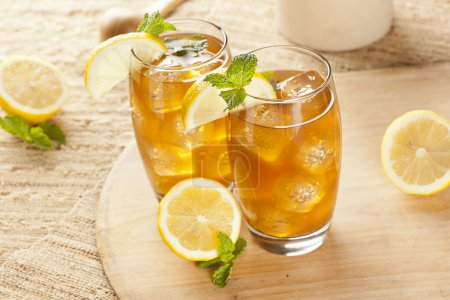 Photo for Refreshing Iced Tea with Lemon against a background - Royalty Free Image