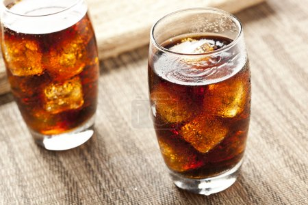 Photo for Refreshing Brown Soda with Ice on a background - Royalty Free Image