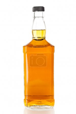 Photo for Bottle of Golden Brown Whisky on a background - Royalty Free Image