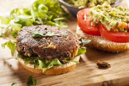 Photo for Homemade Organic Vegetarian Mushroom Burger with tomato and guacamole - Royalty Free Image