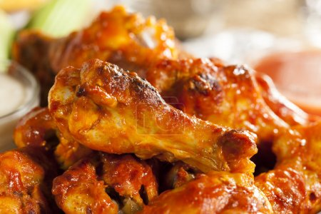 Photo for Hot and Spicey Buffalo Chicken Wings with celery - Royalty Free Image