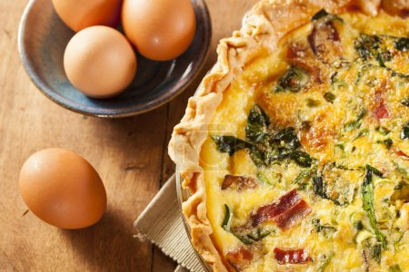 Photo for Homemade Spinach and Bacon Egg Quiche in a pie crust - Royalty Free Image