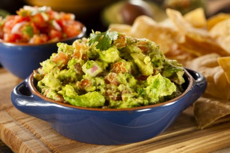 Photo for Homemade Organic Guacamole made with avacados and Tortilla Chips - Royalty Free Image