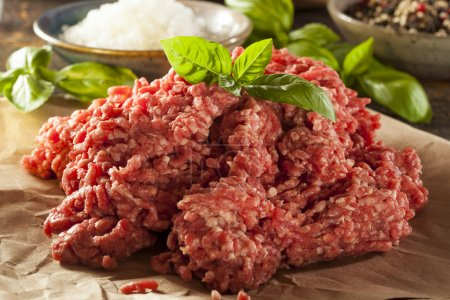 Photo for Organic Raw Grass Fed Ground Beef on Butcher Paper - Royalty Free Image