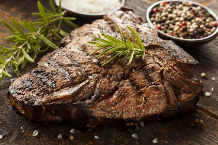 Photo for Grilled BBQ T-Bone Steak with Fresh Rosemary - Royalty Free Image