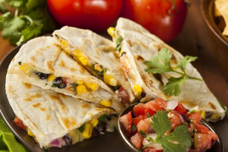 Photo for Homemade Cheese and Bean Quesadilla with Corn and Salsa - Royalty Free Image