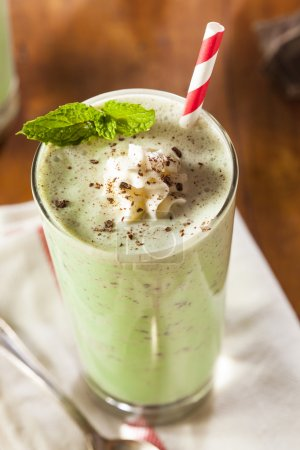 Photo for Cold Refreshing Mint Chocolate Chip MilkShake with a Straw - Royalty Free Image