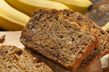 Photo for Homemade Banana Nut Bread Cut into Slices - Royalty Free Image