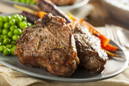 Photo for Homemade Cooked Lamb Chops with Peas and Carrots - Royalty Free Image