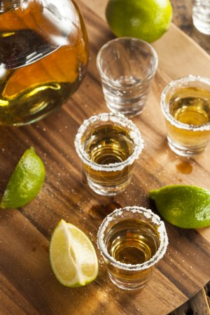 Photo for Tequila in Shot Glasses with Lime and Salt - Royalty Free Image