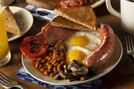 Photo for Traditional Full English Breakfast with Eggs, Bacon, Sausage, and Baked Beans - Royalty Free Image
