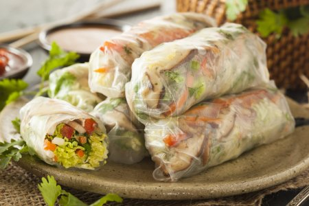 Photo for Healthy Vegetarian Spring Rolls with Cilantro Carrots and Cabbage - Royalty Free Image