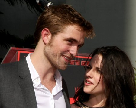 Photo for LOS ANGELES - NOV 3: Robert Pattinson, Kristen Stewart at the Handprint and Footprint Ceremony for the Twilight Saga Actors at Grauman's Chinese Theater on November 3, 2011 in Los Angeles, CA - Royalty Free Image
