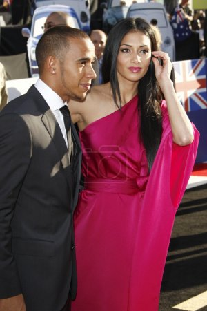"""Photo for LOS ANGELES - JUN 18: Lewis Hamilton, Nicole Scherzinger arriving at the """"Cars 2"""" Premiere at the El Capitan Theater on June 18, 2011 in Los Angeles, CA - Royalty Free Image"""