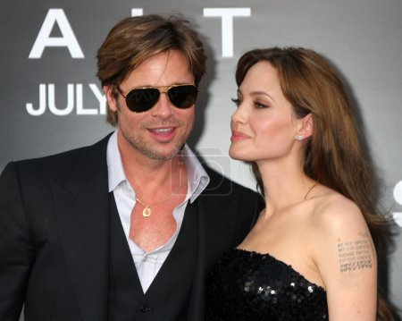 """Photo for LOS ANGELES - JUL 19: Brad Pitt and Angelina Jolie arrive at the """"Salt"""" Premiere at Grauman's Chinese Theater on July19, 2010 in Los Angeles, CA - Royalty Free Image"""