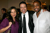 Yancy Arias and Dule and Nicole Hill