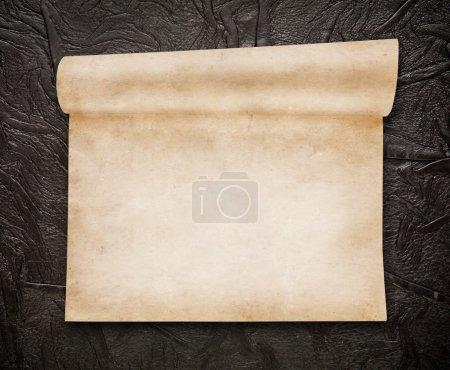 Aged scroll paper, old leather on background