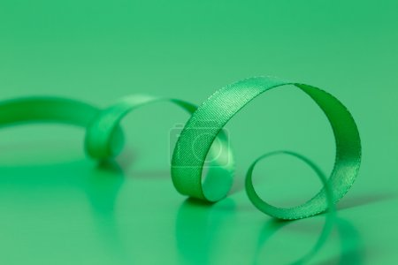 Green ribbon on green background