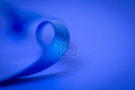 Blue ribbon on blue background