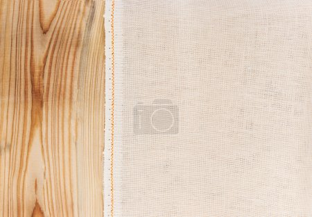 Texture canvas fabric on wooden background