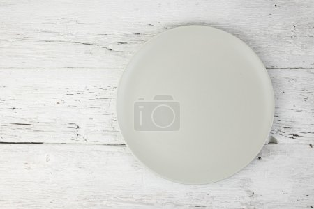Empty clean plate  on white table