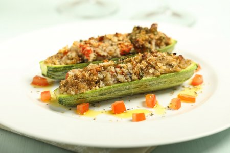stuffed zucchini gratin on white plate