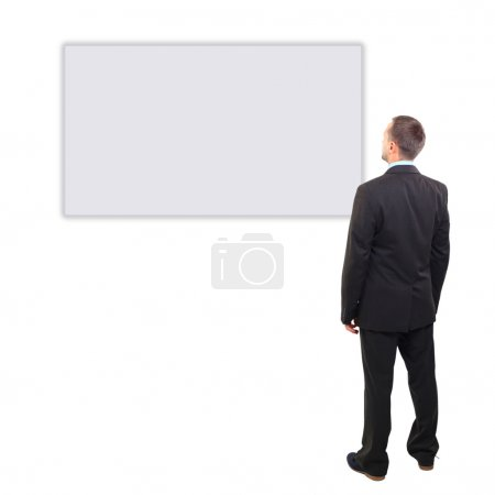 Full length of a handsome business man with hands folded against white background